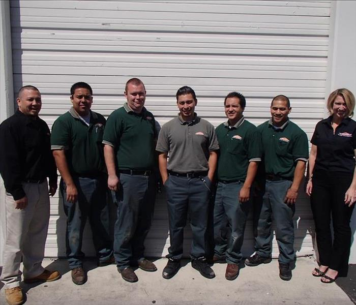 SERVPRO team in front of warehouse